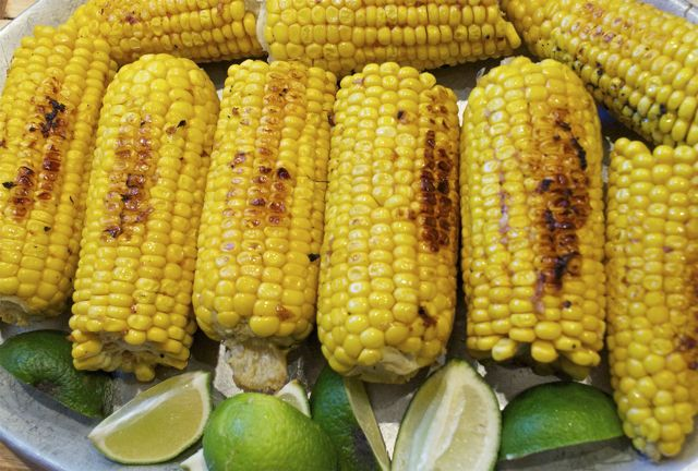corn roasted in a pan with citrus